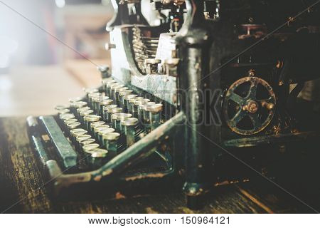 Rusty and Dusty Vintage Typewriter on Table. Retro Typewriter.