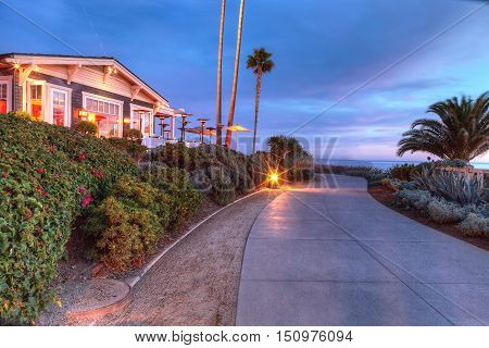 Laguna Beach, CA, USA - October 7, 2016: Sunset view of ocean view restaurant at night at the Montage in Laguna Beach, California, United States