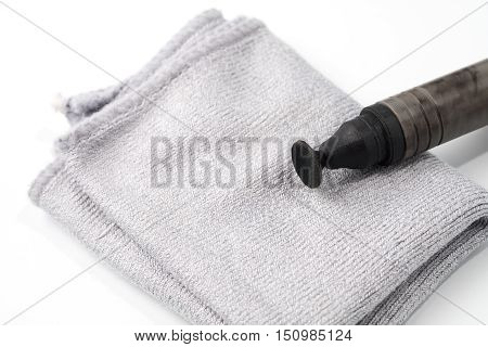 Details of Lens pen for lens optic cleaning isolated on white background.