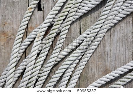 close up of old rope on wooden deck
