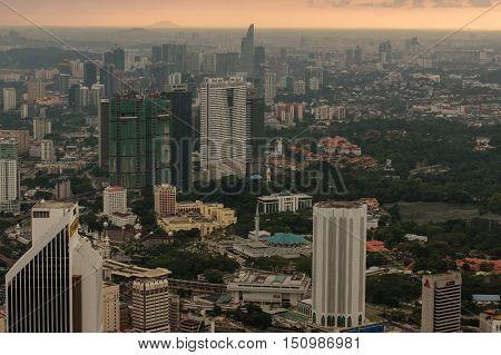 Kuala Lumpur Malaysia - November 17. 2016: Dramatic scenery of the KualaLumpur city at sunset from the KL-Tower Menara KL .
