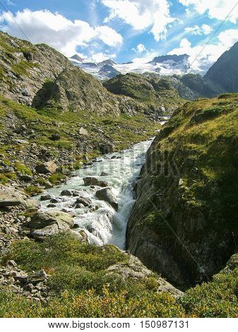 alpine mountain water stream in the mountain of Switzerland on a sunny day