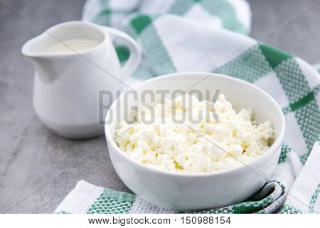 Organic Sour Cream And Cottage Cheese In A White Ceramic Bowl On The Kitchen Table. Dairy Products F