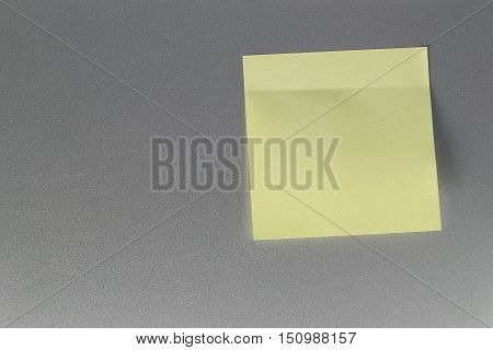 Empty yellow paper sheet on refrigerator door for design and input text to concept food and drink etc.