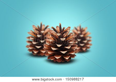 Three cones on blue backlit background. Focus on foreground