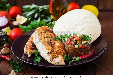 Grilled Chicken Breast With Fresh Tomato Salsa And Pita.