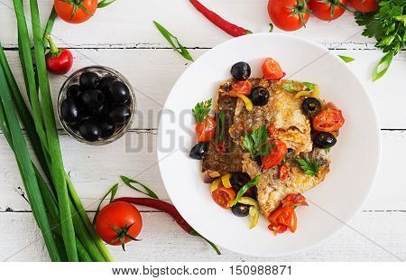 Fried Hake Fillet With Tomato And Olives In The Mediterranean Style. Top View