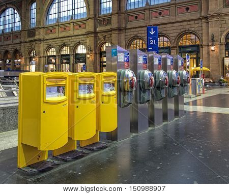 Zurich, Switzerland - 9 October, 2016: postboxes and payphones in the hall of the Zurich main railway station. Zurich main railway station is the largest railway station in Switzerland and one of the busiest railway stations in the world.