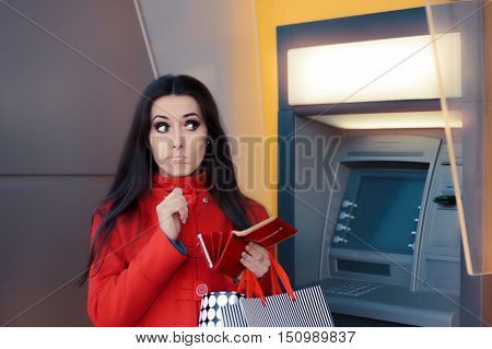 Funny Shopping Woman Holding a Penny in front of an ATM