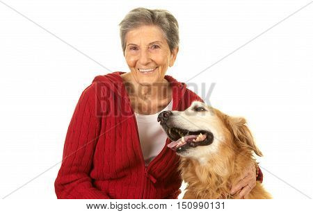 Elderly Woman happy with her pet dog golden retriever.  She is smiling.  Shot on a white background.