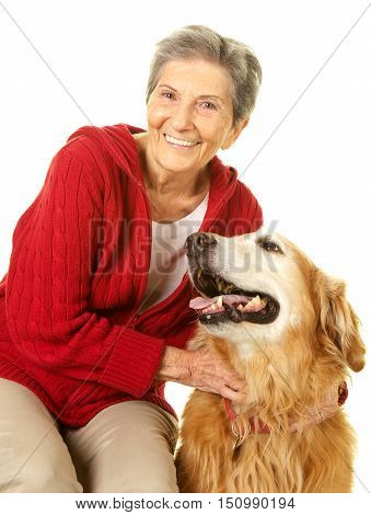 Elderly Woman happy with her pet dog golden retriever.   Shot on a white background.