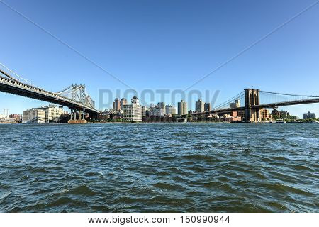 New York City - Sept 15, 2012: Panoramic view of the Manhattan Bridge and the Brooklyn Bridge as seen from the East Side of Manhattan New York.