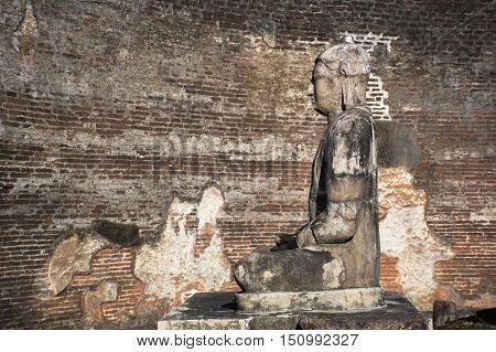 Ancient City of Polonnaruwa, stone Buddha statue at Vatadage (Circular Relic House) in Polonnaruwa Quadrangle, UNESCO World Heritage Site, Sri Lanka, Asia.