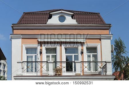 Odessa, Ukraine - August 28, 2016: Top of small private two-storied residential house with balcony