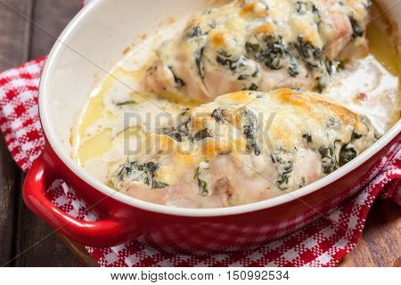 Roasted hasselback chicken breast stuffed with ricotta cheese and spinach. Low carb diet