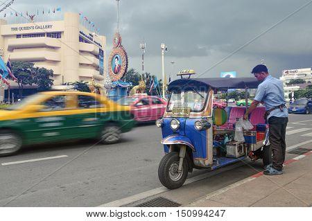 BANGKOK,THAILAND- OCTOBER 8 : Tuktuk and the driver at Rachadumneon Road, Bangkok, Thailand.