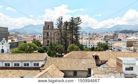a beautiful view of the central park and cathedral of Cuenca Ecuador with the mountains as backgroung