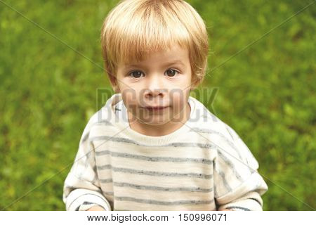 Charming Close-up Innocent Portrait Of Little Innocent Kid. Calm Caucasian Boy With Blond Hair, Roun