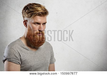 Portrait Of Courageous And Fashionable Male Model With Long Trendy Beard And Undercut Hairstyle. Cau