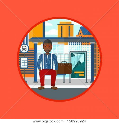African-american man waiting for a bus at the bus stop on a city background. Young man sitting at the bus stop at the city street. Vector flat design illustration in the circle isolated on background.