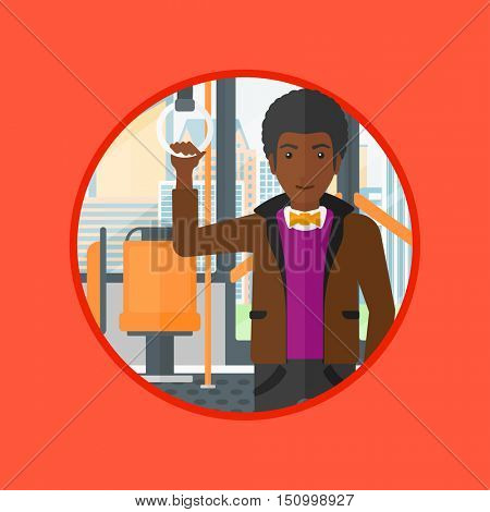 African-american man traveling by public transport. Man standing in a public transport. Man traveling by passenger bus or subway. Vector flat design illustration in the circle isolated on background.