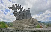 A communist-era war memorial to the dead partisans of World War Two in Grahovo in Montenegro. The park is named Memorial Park to the Uprising and the Revolution. poster