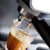 Espresso machine brewing a coffee espresso poster