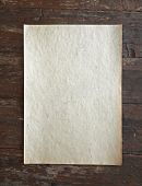 old paper on dirty wooden background poster