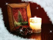 christmas card, vintage photo-frame on a table at candlelight poster