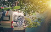 Ultimate RV Escape. Outdoor Men and His Camper Motorhome. Men Attaching His Kayak on the Camper Roof. poster