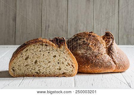 Spelt Quinoa Sourdough Bread On A White Table Board