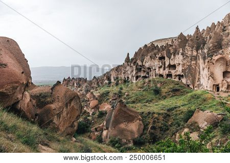 majestic view of scenic caves and bizarre rock formations in famous cappadocia, turkey poster