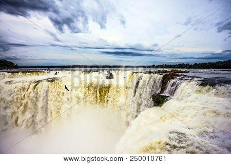 Spectacular journey to the grandiose exotic waterfalls. Grandiose waterfalls Iguazu in the rainy season. Garganta del Diablo. Concept of ecological tourism