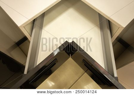 Opened angled drawer with organizer, ideal solution for corner cupboards poster