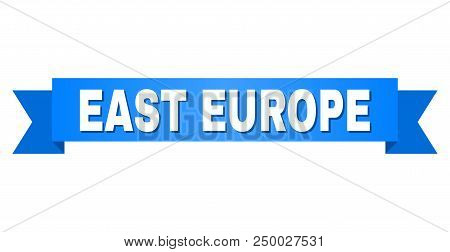 East Europe Text On A Ribbon. Designed With White Caption And Blue Stripe. Vector Banner With East E