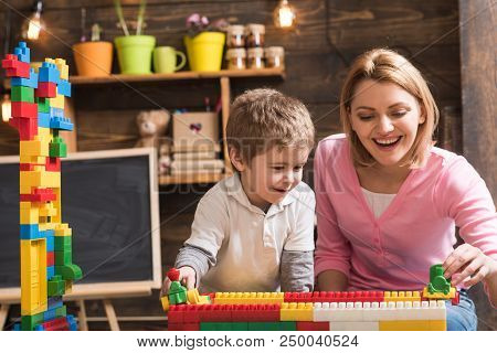 Mothers Day Concept. Mother And Son Play With Toy Bricks On Mothers Day. I Have Mothers Day Everyday