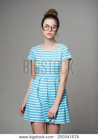Student. Pretty Student Girl In Glasses. Student Fashion Of Woman In Glasses And Summer Dress. Stude