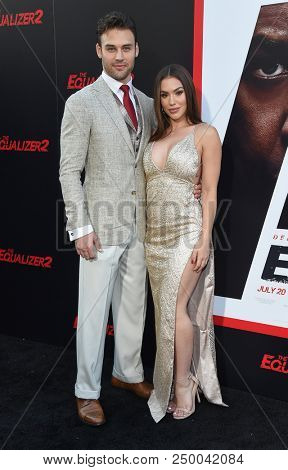 LOS ANGELES - JUL 17:  Ryan Guzman and Chrysti Ane arrives to the 'The Equalizer 2' Los Angeles Premiere  on July 17, 2018 in Hollywood, CA