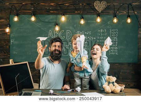 Vacation Concept. Happy Family Launch Paper Planes In Class, Vacation. School Vacation And Holidays.