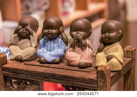 Little Monks, Close Up Of Hand Small Statues With The Concept Of See No Evil, Hear No Evil, Speak No