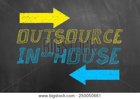 Outsource In House Text And Arrows On Blackboard.