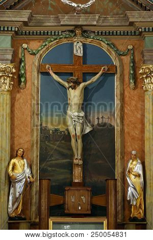 ZACRETJE, CROATIA - AUGUST 06: Crucifixion, altarpiece in the Parish Church of the Holy Cross in Zacretje, Croatia on August 06, 2017.