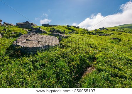 Cloud Over The Grassy Hillside With Rocks. Path Uphill In To The Sky. Lovely Summer Scenery. Tacking
