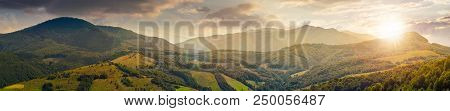 Panorama Of Beautiful Mountain Ridge At Sunset In Evening Light. Perfect Countryside Landscape. Rura