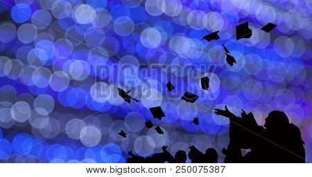 Silhouette Of Graduate Students Throw Mortarboards In University Graduation Success Ceremony. Congra
