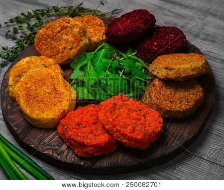 Vegetables Patties (cutlets) For Vegan Burgers In Bowl. Mix Vegetables Stack Fresh Burgers. Spices F