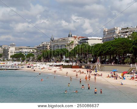 Cannes, France - June 28, 2018: Vacationers Enjoy The Beautiful Weather At The Public Beach At The E