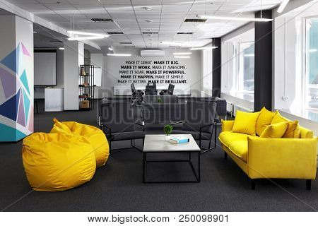 Creative Space.with Yellow Sofa And Yellow Bean Bag And Coffe Table In The First Plan And Conference