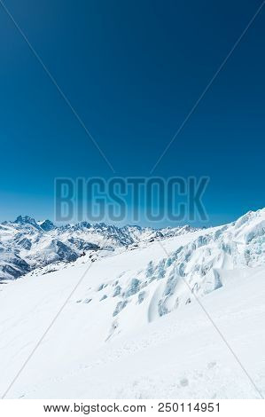 Winter Snow Covered Mountain Peaks In Caucasus. Great Place For Winter Sports.