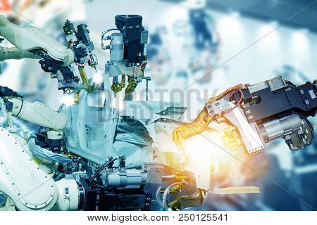 Iot Smart Factory , Industry 4.0 Technology Concept, Robot Arm In Automation Factory Background With